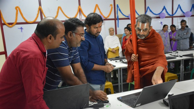 HH Chinna Jeeyar Examining Laptops Of Blind College Students